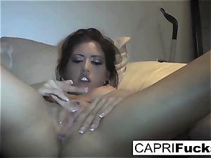 Capri Cavanni play with her moist coochie