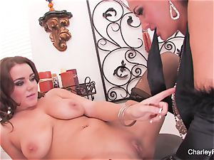 Charley and Natasha have fun with a double faux-cock