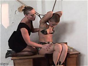 Kathia Nobili and C J stunner binding of forearms