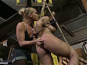 Kathia Nobili smacking the backside of warm lady with cane